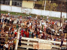 People affected by the cyclone waiting for aid
