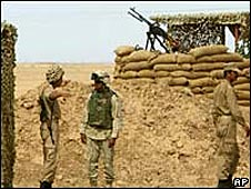 US soldier talks with an Iranian Mujahideen fighter