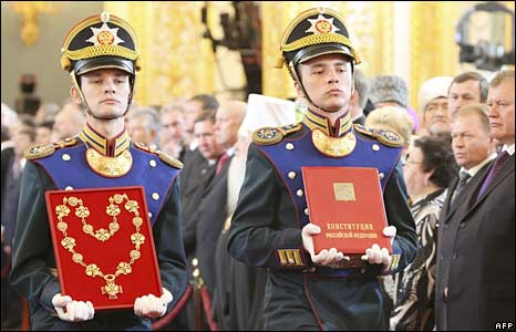 Honour guards bring in the chain of the presidential office and a copy of Russia's constitution