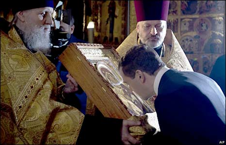 Dmitry Medvedev kisses an icon during a service in the Assumption Cathedral