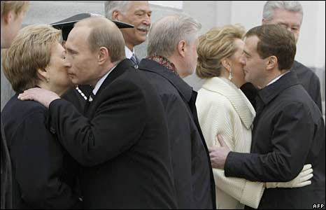 Vladimir Putin (2nd left) embraces the widow of former President Boris Yeltsin, Naina (left), as Dmitry Medvedev (right) hugs his wife Svetlana (2nd right)