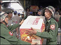 Burmese soldiers unloading aid supplies from a Thai transport plane