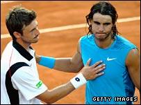 Juan Carlos Ferrero (L) consoles compatriot Rafael Nadal