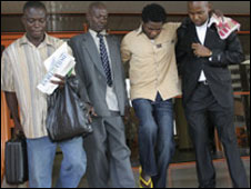 Ugochukwu Nwaokporo (2nd from right) is helped from court