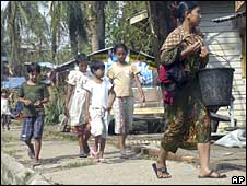 residents of Rangoon look for water after the cyclone