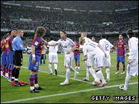 Barcelona's players applaud champions Real Madrid on to the pitch