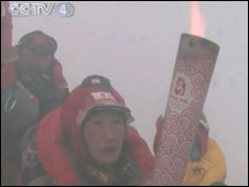 Olympic torch on summit of Everest