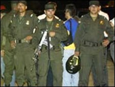 Colombian police stand guard near the scene of the Jamundi shooting