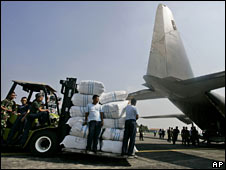 Troops load a military plans with supplies in Jakarta, Indonesia