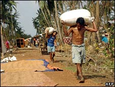 People carry their belongings in Dedaye, south of Rangoon, on 7 May 2008