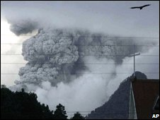 A cloud of smoke and ashes from the Chaiten volcano are seen over Chaiten, Chile