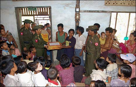 Senior military officials give relief goods to homeless families in Rangoon, 8 May 2008