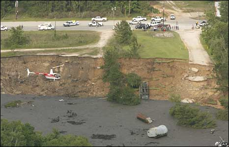 A helicopter flies over sinkhole 7 May 2008
