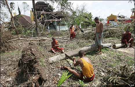 Monks cut up fallen trees in Kyauktan township, southern Burma