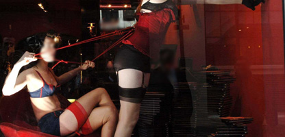 Two women performing erotic show