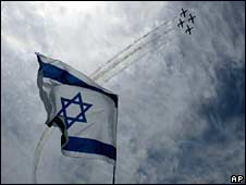 Israeli air force jets perform a display during a demonstration to mark the 60th anniversary of Israel
