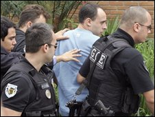 File photograph of Alexandre Nardoni being taken in for questioning by police in April 2008