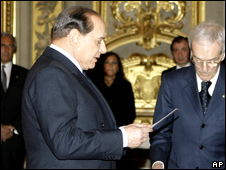 Silvio Berlusconi reads the oath of office