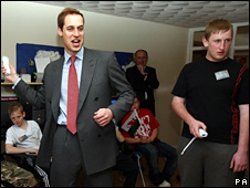 Prince William playing a computer game