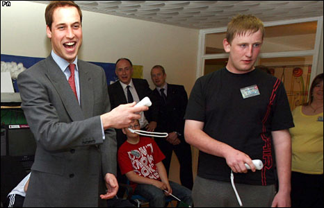 Prince William plays a game on a  Wii console with Martyn James during a visit to the Valleys Kids Project.