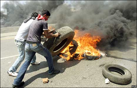 Lebanese supporters of the government loyalist Future Movement set up a road block of burning tyres on the road from Beirut to Saida