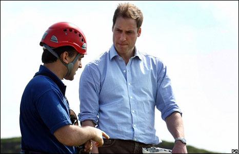 Prince William receives his instructions before a casualty is lowered down.