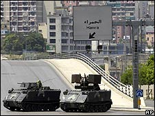 Lebanese army vehicles block a road in Beirut on 8 May