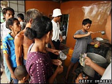 People waiting for cooking oil in Burma
