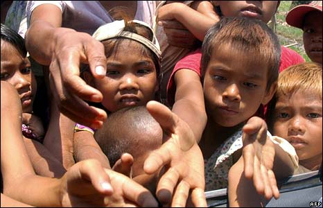 Children beg passengers in a car for food in Bogalay on 8 May 2008