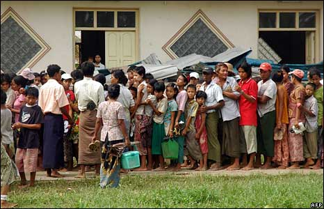 Villagers queue up for relief goods in Bogalay, one of the worst-affected areas, on 8 May 2008
