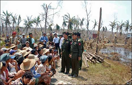Burmese Prime Minister Thein Sein (2nd R) meets cyclone-hit people near Rangoon on 8 May 2008