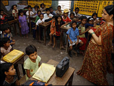 Students listening to a radio broadcasting the English programme at a school in Patna, Bihar