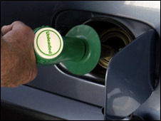 Man filling car with petrol