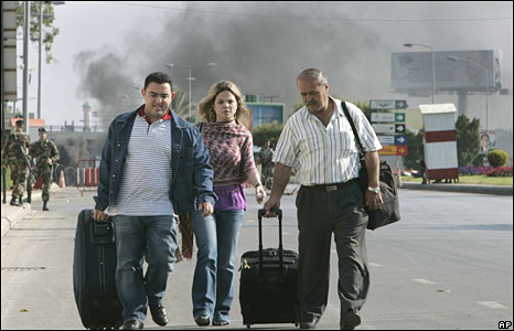 Passengers walk towards the airport terminal building in Beirut on 8 May 2008