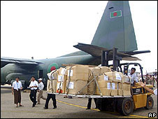 Relief supplies from Bangladesh are unloaded at an airport in Yangon 7 May