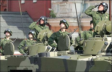 Russian soldiers ride across Red Square in an armoured personnel carrier during a Victory Day Parade in Moscow on May 9, 2008.