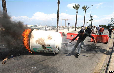 A Hezbollah member blocks a road on the Beirut seafront on 9 May 2008