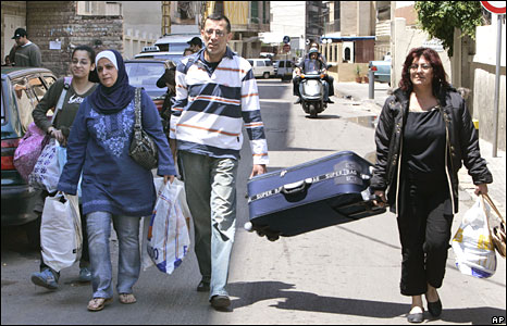 A Lebanese family flee their home in an area recently taken by Hezbollah on 9 May 2008