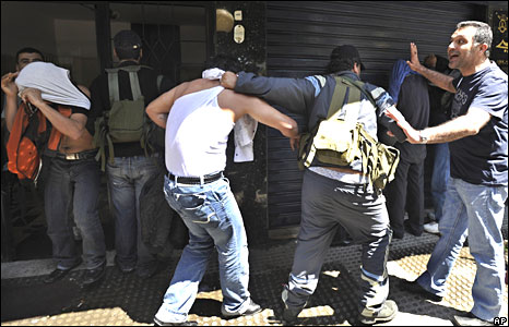 Shia gunmen detain Sunni government supporters in Beirut on 9 May 2008