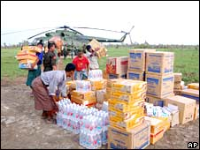 relief supplies for Cyclone survivors are unloaded from a helicopter in a village in the hardest-hit Irrawaddy delta