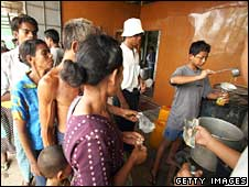People wait in line to buy cooking oil on May 8, 2008 in downtown Rangoon
