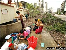 People use available water supplies to cleanse themselves on May 8, 2008 in Rangoon