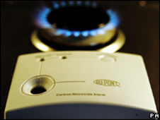 A carbon monoxide detector and a gas hob
