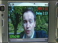 Dan Simmons using the Qik software on a mobile phone
