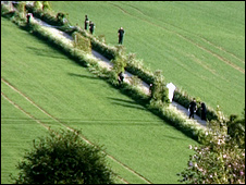 Police and forensic teams investigate the scene