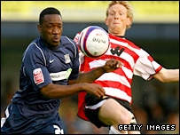 Southend's James Walker and Paul Green of Doncaster battle for possession