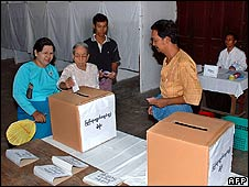People vote in a polling station in Mandalay