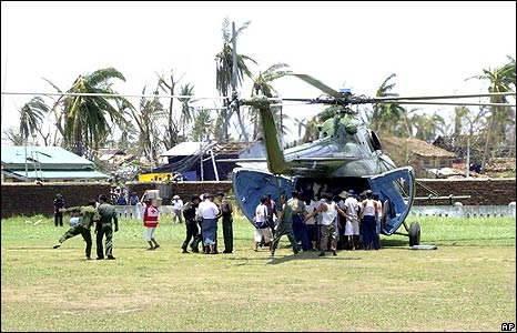 A helicopter carrying aid lands in Bogalay on 9 May
