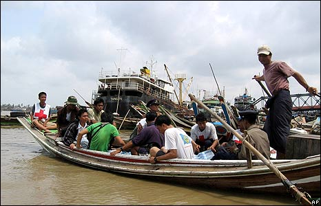 Burmese aid workers deliver water by boat to victims on the outskirts of Rangoon on 9 May