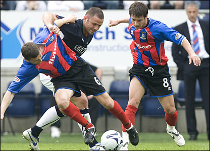 Falkirk's Michael Higdon (centre) battles for the ball with Inverness' Roy McBain and Ian Black (8)